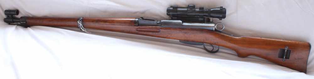 Schmidt Rubin K31 rifle scoped. S/H Image